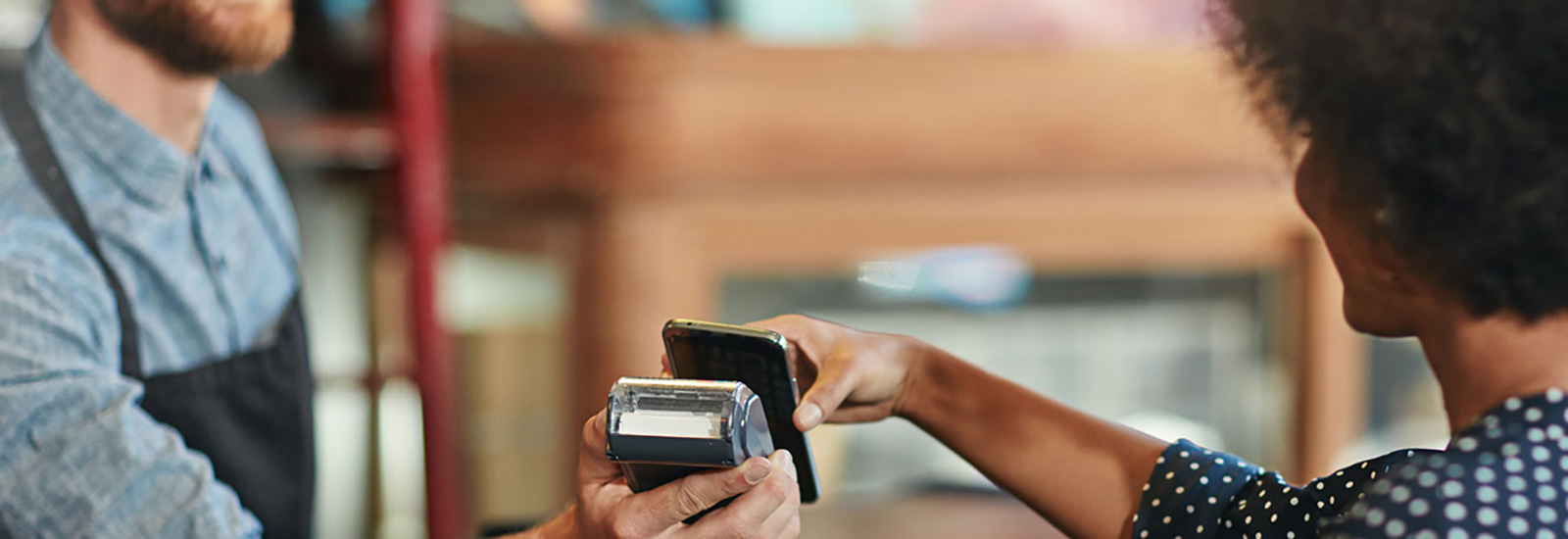 Woman paying with phone