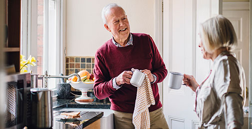 Retired couple talking in kitchen
